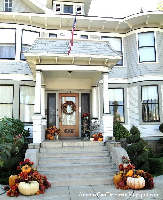 Fall porch with pumpkins and gourds