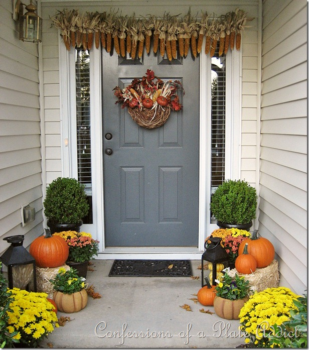 fall porch idea with corn and mums