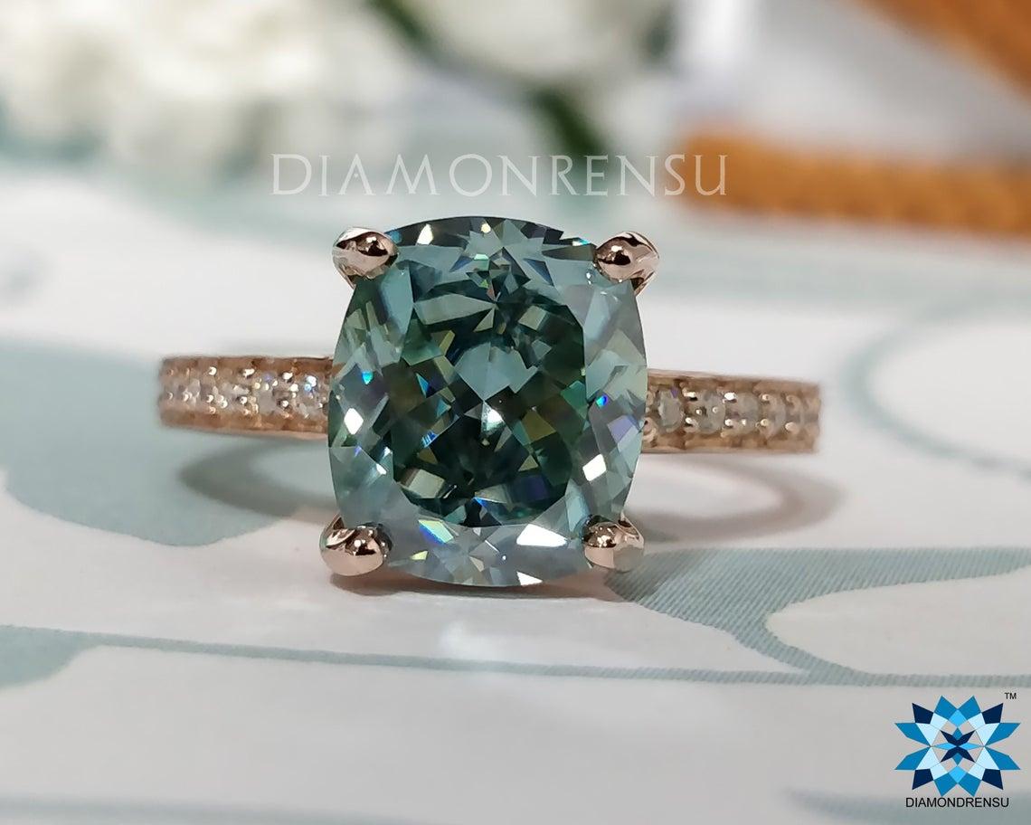 Aqua colored moissanite ring