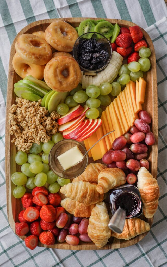 Brunch Charcuterie Board with fruit, donuts and croissants