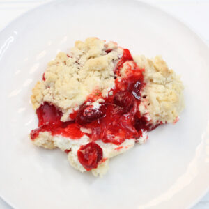 Strawberry Cheesecake Dump Cake is a super simple, four ingredient recipe that's ready in just thirty minutes.